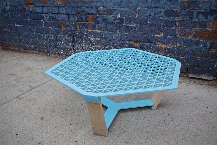 Mariani coffee table in blue with perforated top.