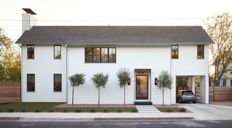 White gabled two-story home in Austin
