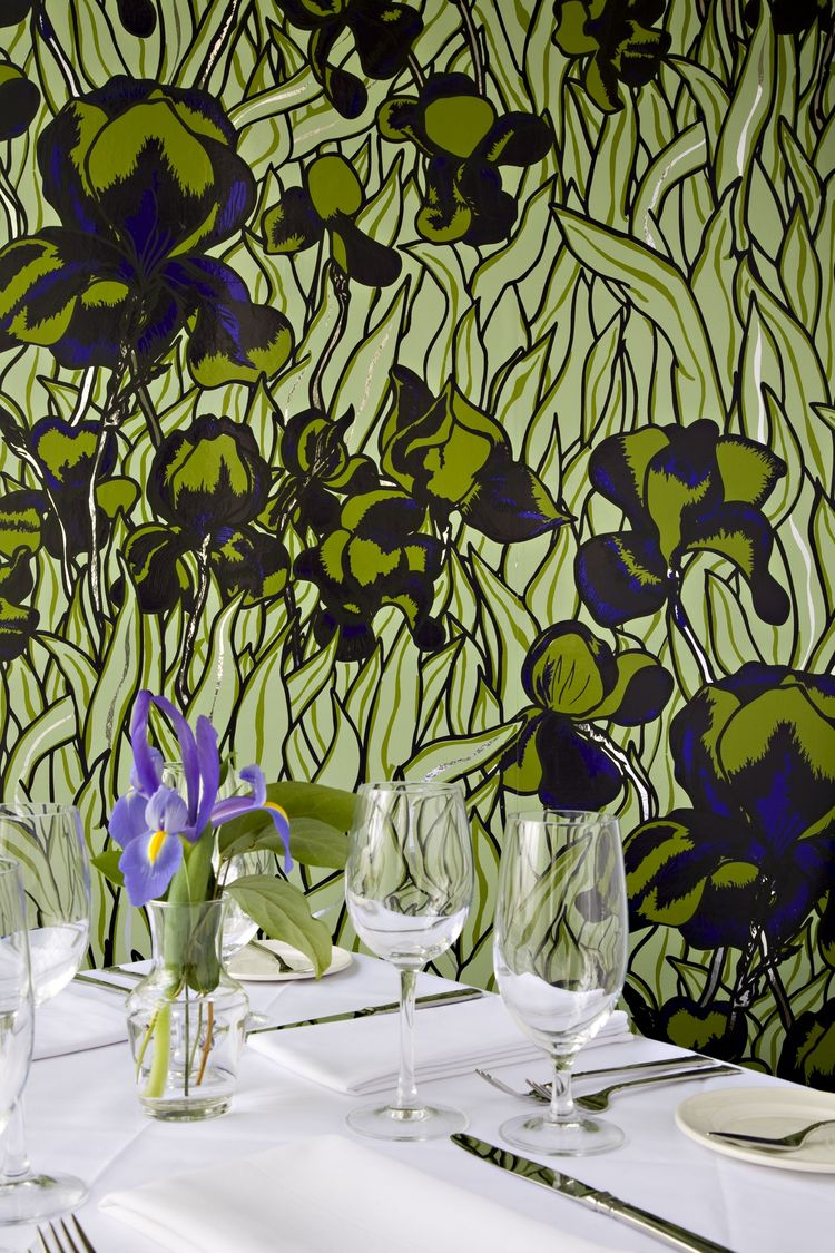 Iris wallpaper over a dining table