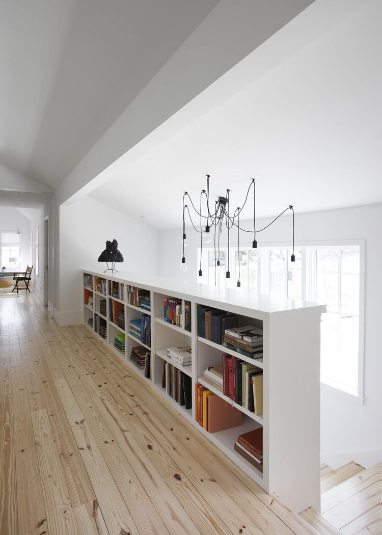 Landing with draped chandelier and a bookcase