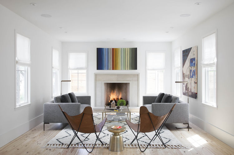 Modern living area with butterfly chairs and a rainbow print