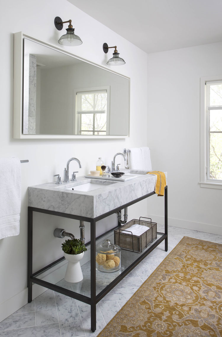 Master bathroom with a marble double-sink