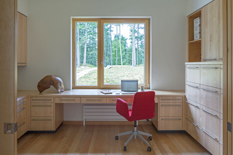 Shaw Island Prefab Passive House office with red chair.