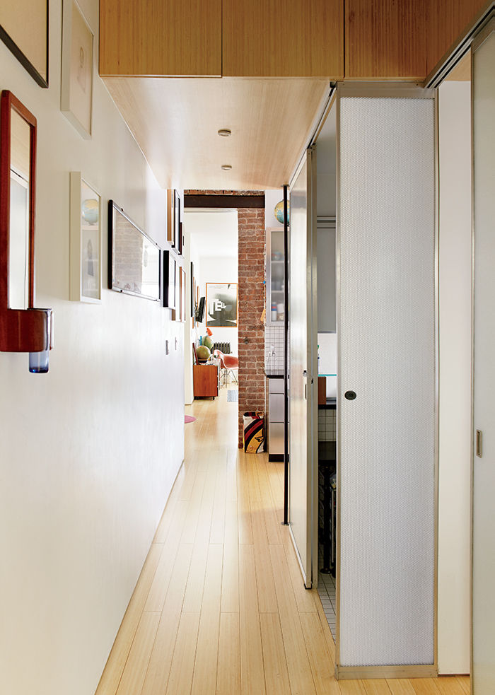 Hallway with bathroom encased in Panelite that illuminates at night