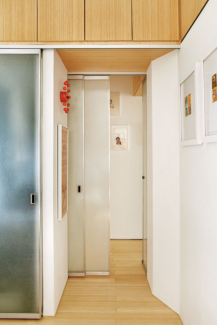 Renovated hallway with bamboo-plywood storage compartments