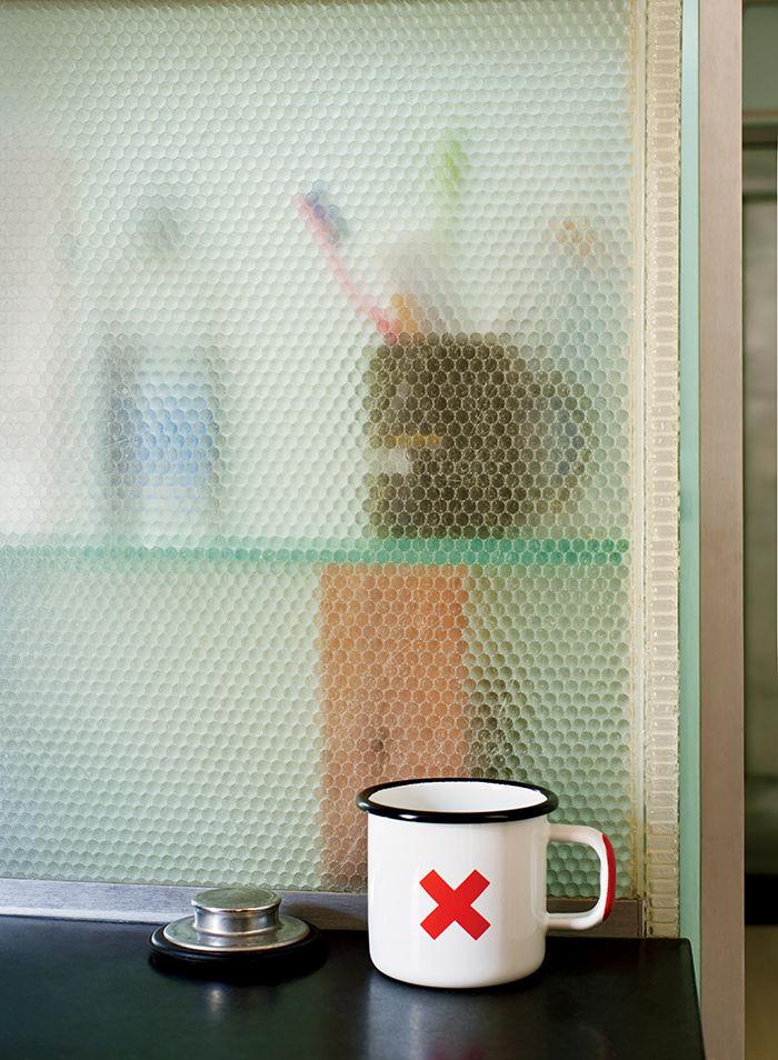 Panelite divides bathroom cabinet and kitchen backsplash