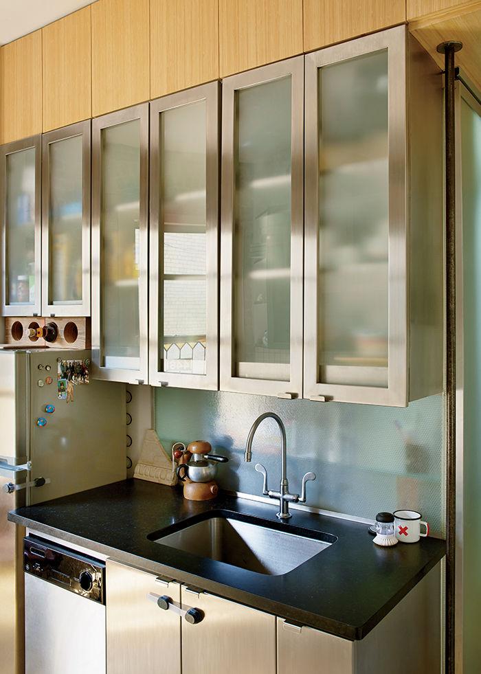 Metal kitchen cabinets with translucent Panelite backsplash