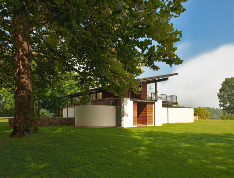Side view of summer house with angled copper roof