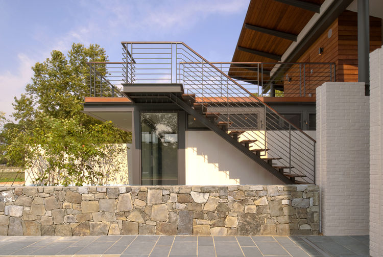 Original stone diving wall with stairs leading to roof deck