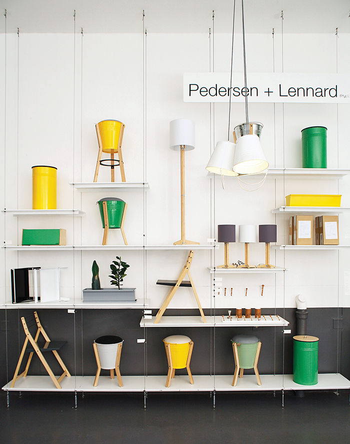 Furniture wall in Cape Town with bright bucket stools