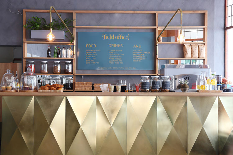Field Office coffee shop with golden bar with menu board