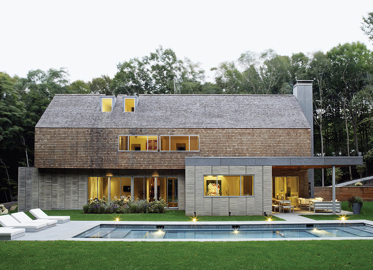 Hamptons modern pool off gabled house with cedar paneling