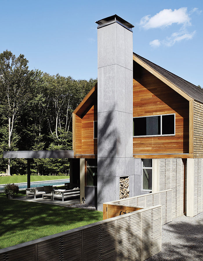 Hamptons house exterior with precast concrete panels with wood framing