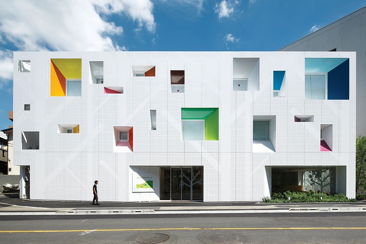Tokyo bank with white facade and colorful punched out windows