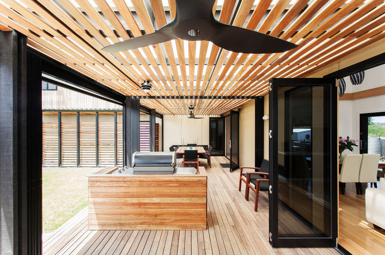 Byron Bay house wood-clad deck with fan.