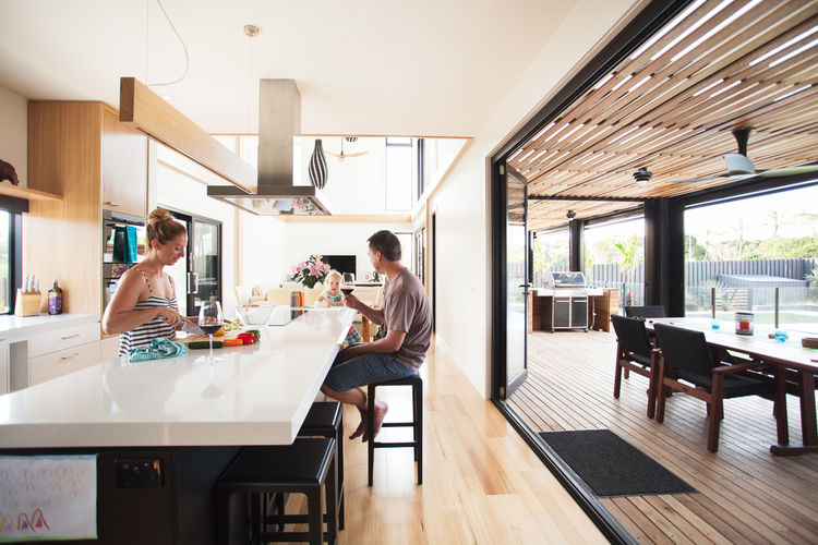 Byron Bay house kitchen with family.