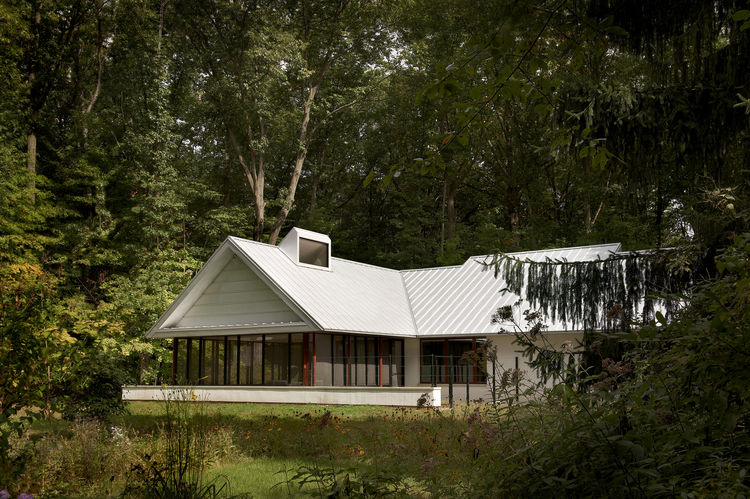 The Harbert Cottage with a gabled white roof in Michigan