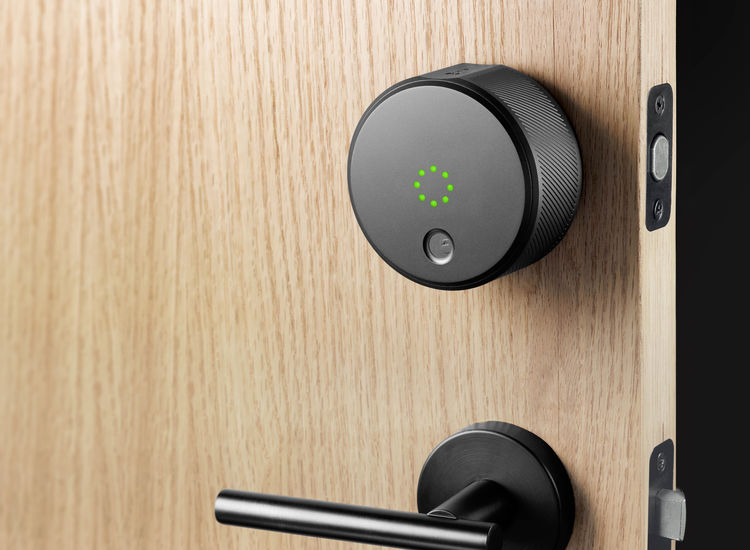 August smart lock with black metal finishes