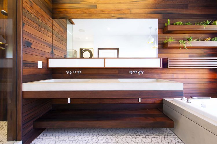 Modern wooden bathroom renovation with large concrete sink
