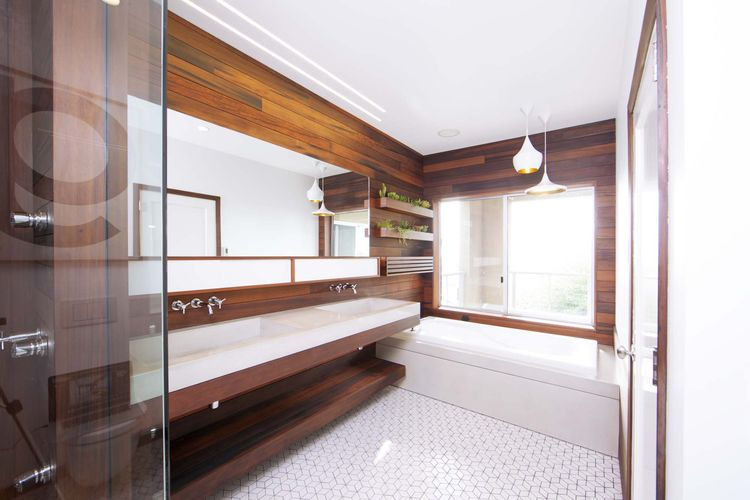 Modern wood-lined bathroom renovation with white tile