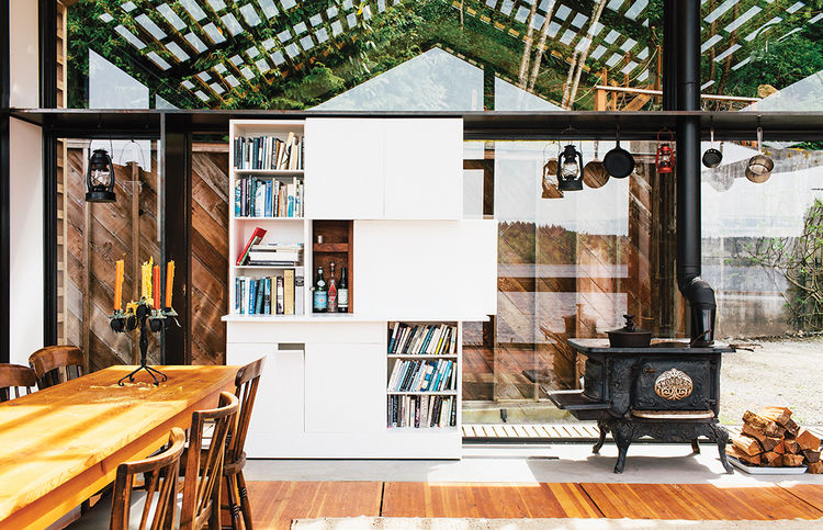 Glass-walled garage for entertaining with Corian bookshelf