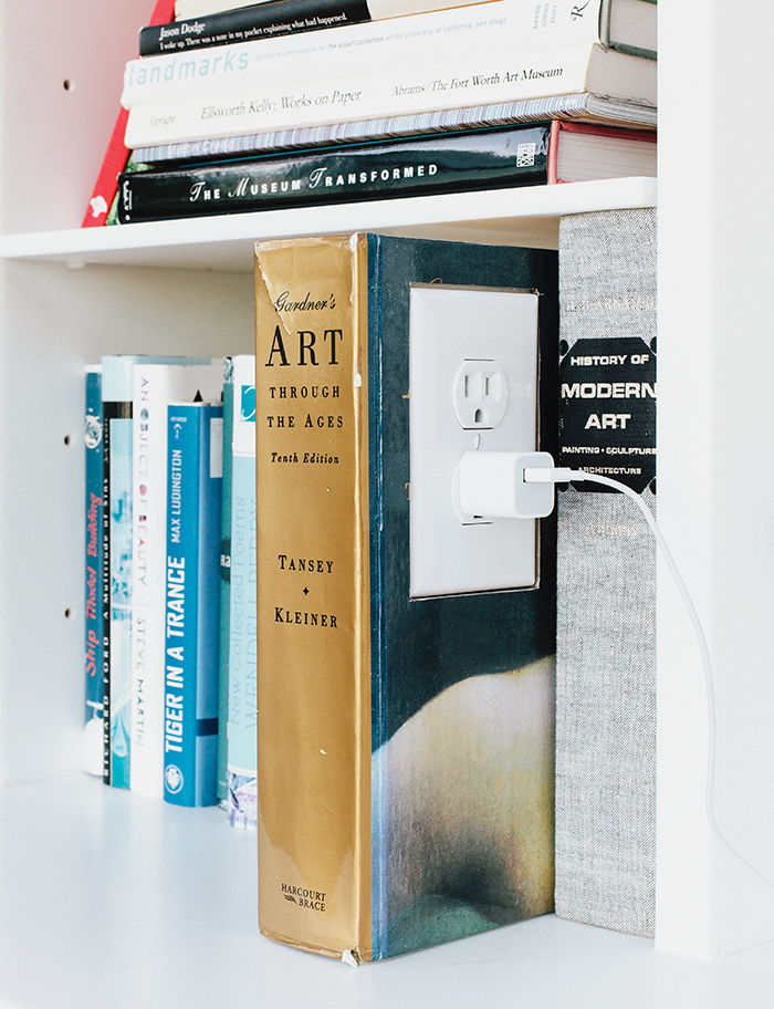 Bookshelf with playful outlet in a book
