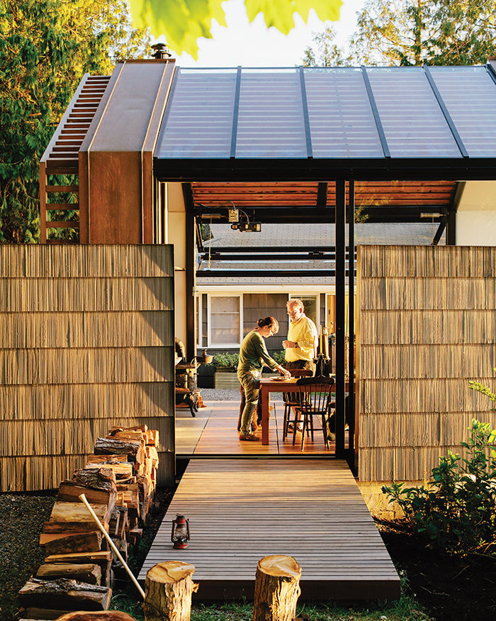 Garage with shingled walls and a cedar deck