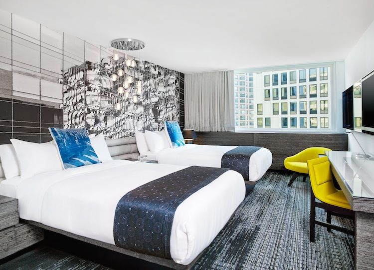 W Hotel Lakeshore guest room with mirrored headboard and metallic palette
