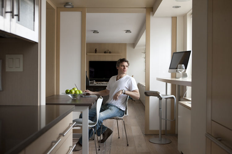 Raydoor founder Luke Siegel with oak and glass sliding doors