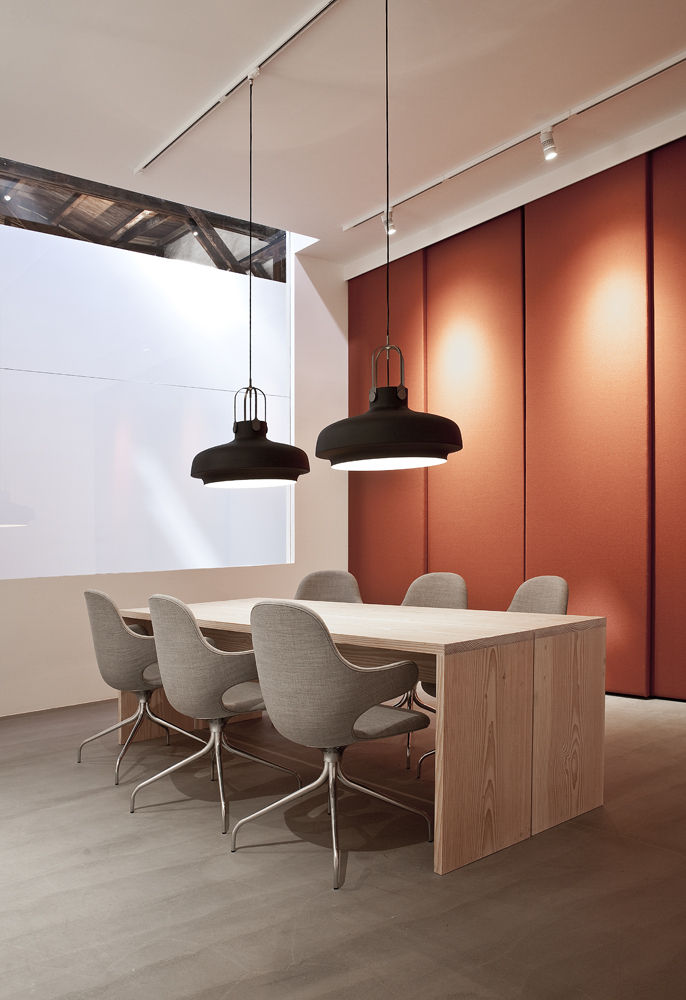 Black pendant lamps by Space Copenhagen and Catch fabric chairs by Jaime Hayon for &Tradition