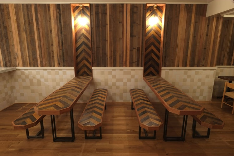 Torst bar wood communal tables with geometric pattern