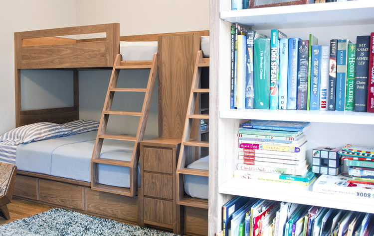 white bookshelves and walnut wood bunk bed in a kids' room