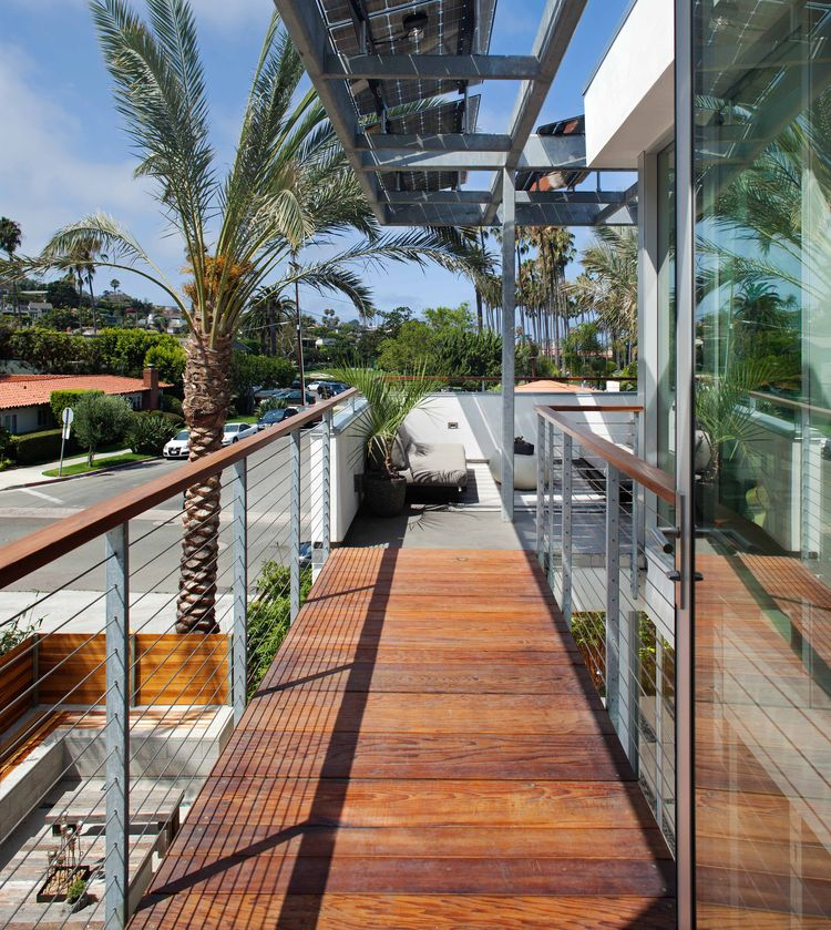 Accordion-style glass wall opens onto balcony.