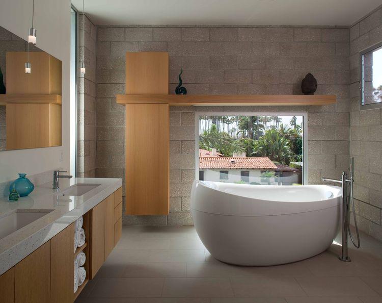 Bathroom with plentiful windows and deep tub.