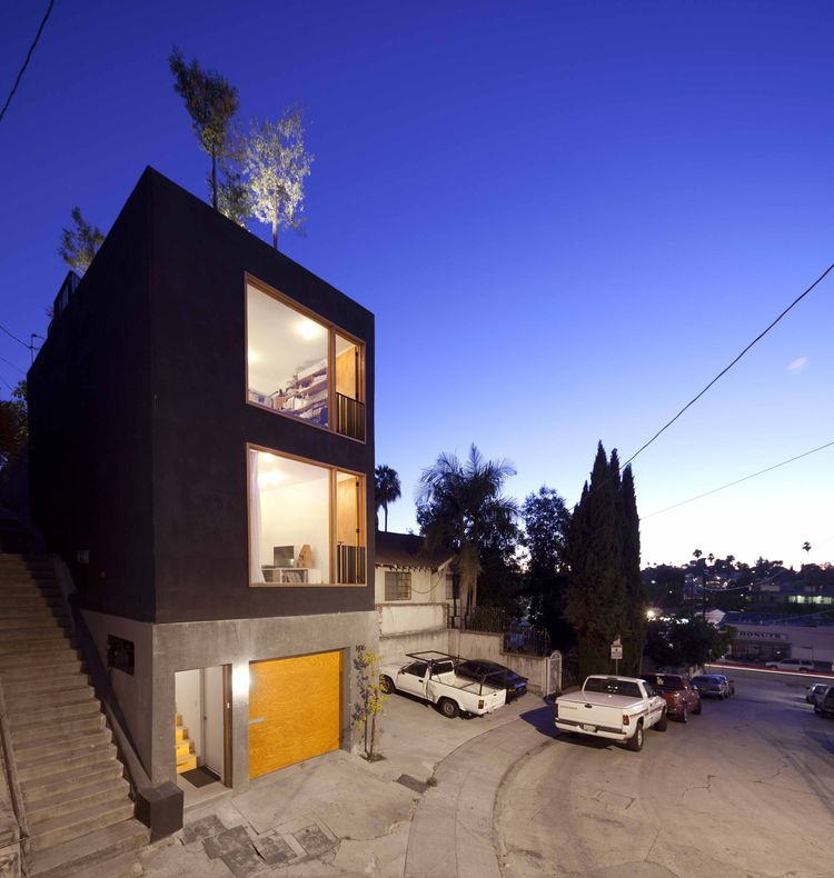 Narrow exterior with black facade in Los Angeles