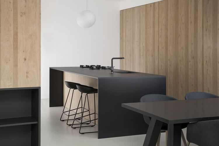 Minimal Amsterdam kitchen with black countertops