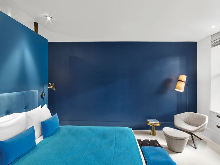Manhattan hotel room with vivid blue interior
