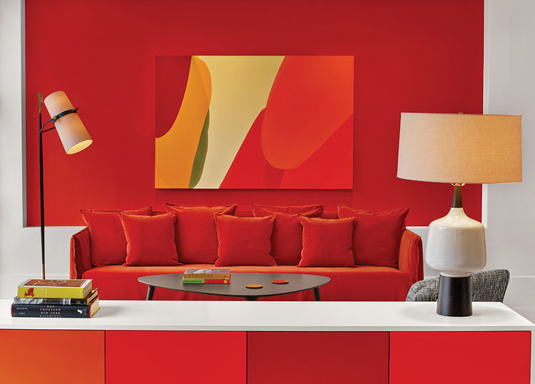 Manhattan hotel room with orange and red walls and sofa