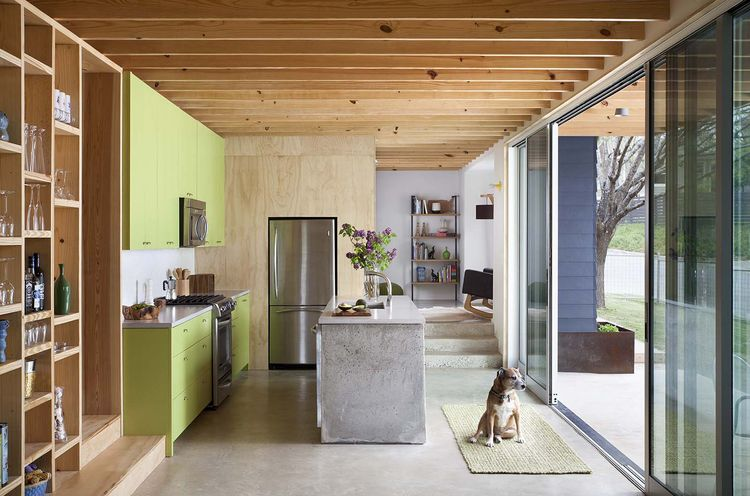 modern kitchen with green cabinets and concrete counters