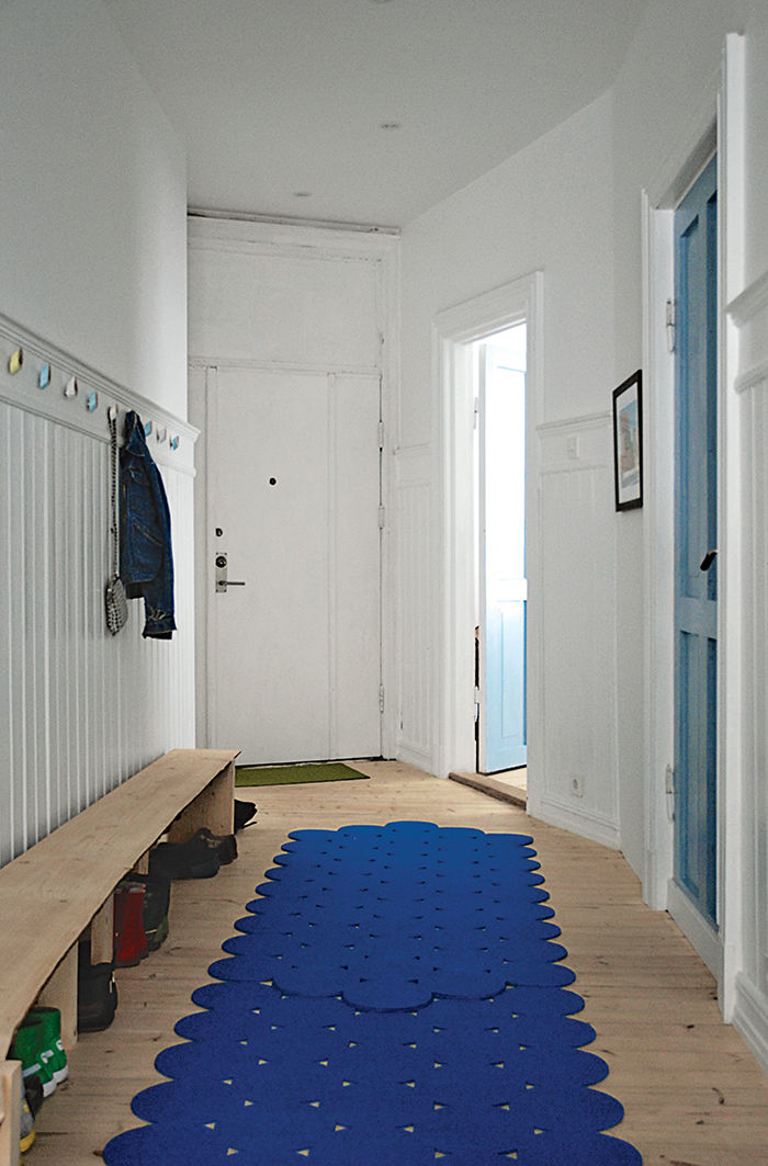 Oslo hallway with blue-painted laundry room door