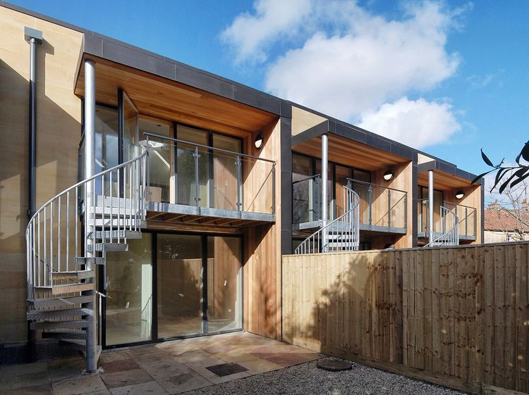 Ralph Allen Yard housing development with south-facing windows and rainwater collection system