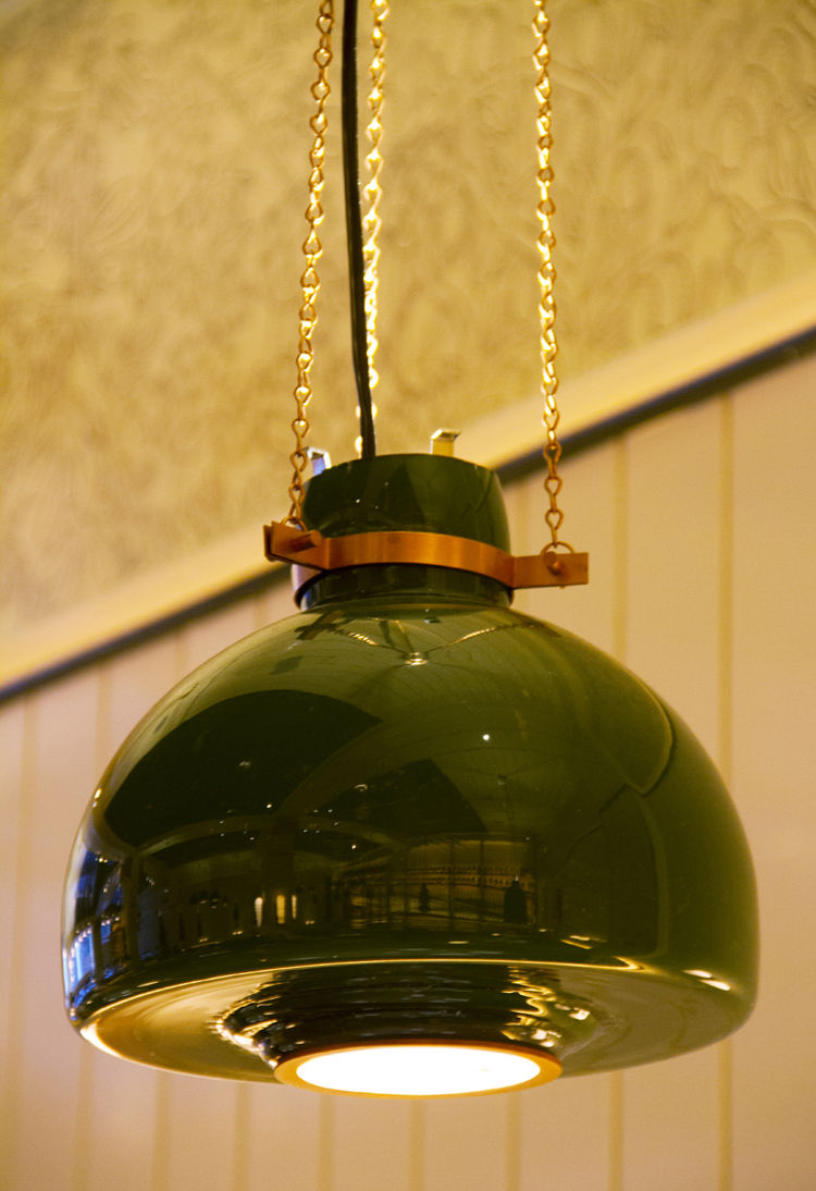 Roman and Williams New York City restaurant design for Upland with painted glass pendant lamp