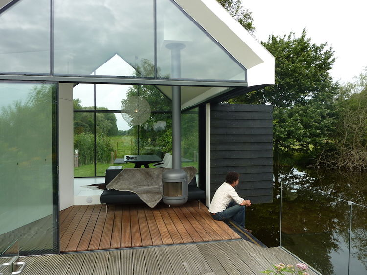 Prefab cabin with fold out wall that opens onto lake