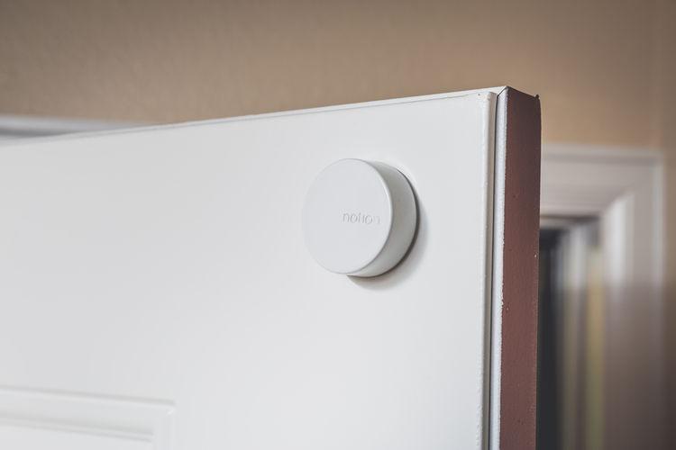 Home security sensor placed on door frame