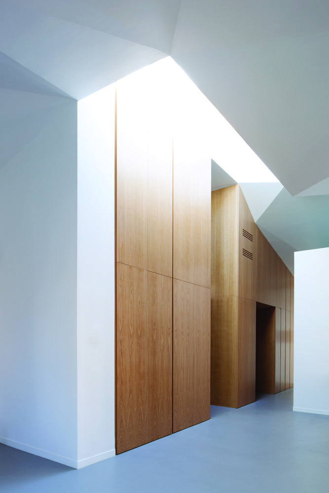 Renovated Art Deco apartment in Rome by SCAPE includes elm millwork and faceted enamel ceilings