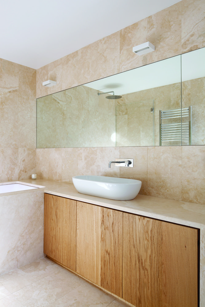 Renovated Art Deco apartment in Rome by SCAPE includes elm millwork and a travertine bathroom