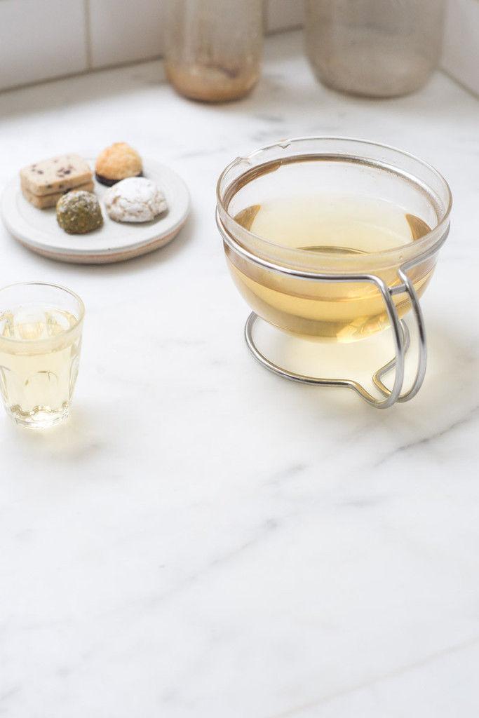 glass tea pot on metal stand