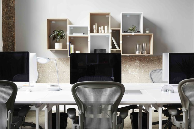 Dots office with modular shelving and cork board on the walls