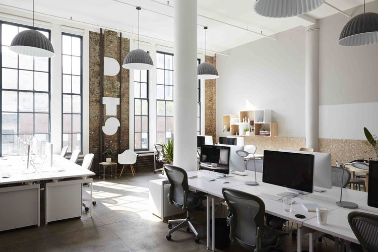 Dots office with Muuto gray lamps and Herman Miller office chairs