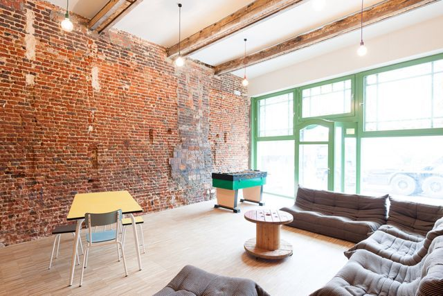 Lounge in Backstay hostel in Ghent, Belgium, with Ligne Roset Togo sofas
